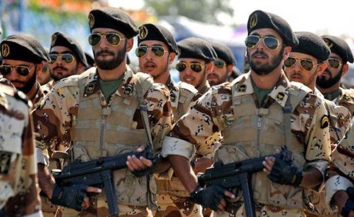 soldiers from iran carrying guns