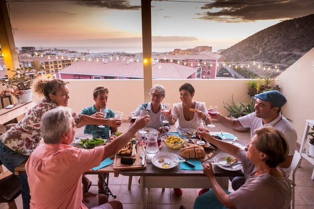 family eating and drinking around table