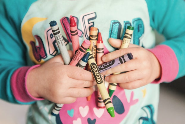 holding crayons