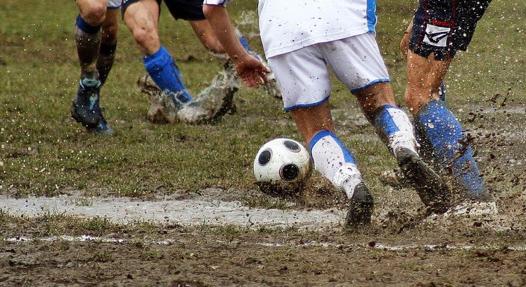 playing soccer in the mud