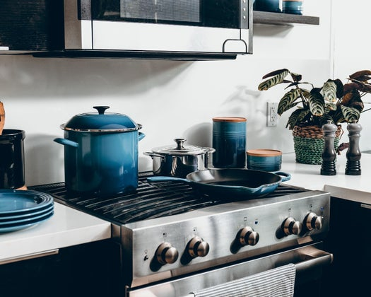 kitchen stove with pots on top