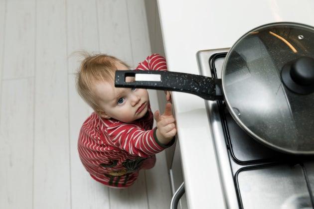 baby reaching for pan