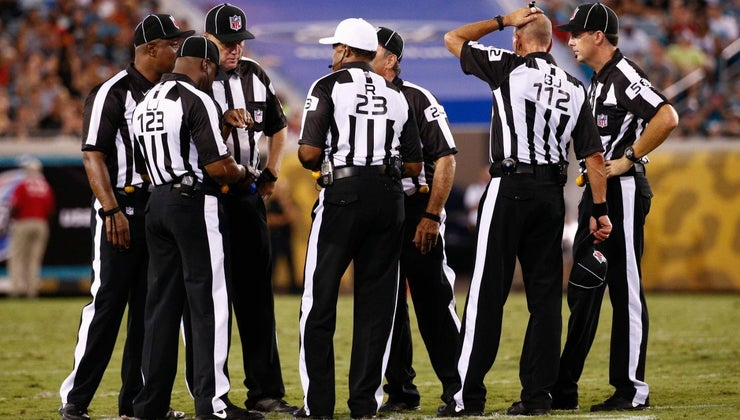 many-officials-field-during-football-game