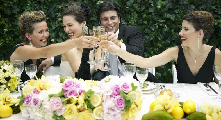 sits-head-table-wedding-reception