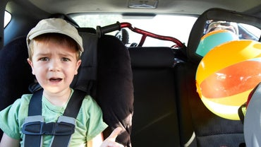 What Is the Age a Child Needs to Be to Ride in the Front Seat?