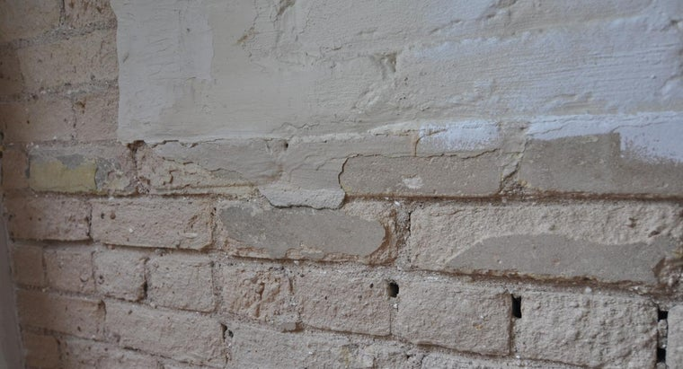 can-drywall-over-brick