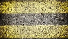 What Do Solid, Parallel Yellow Lines Mean on a Road?