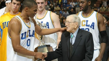 Who Was the First Person Inducted Into the Basketball Hall of Fame As a Player and Coach?
