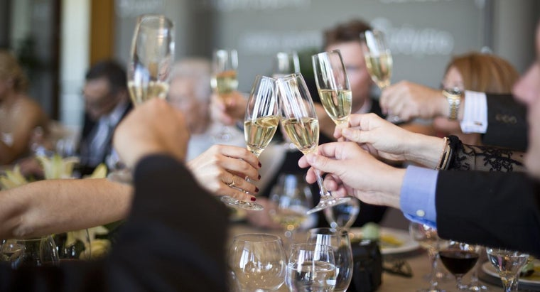 many-people-bottle-champagne-serve