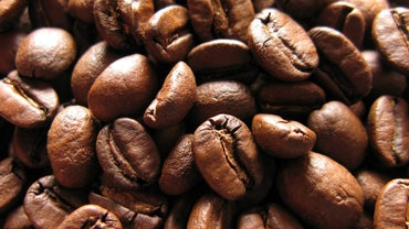 What Is the Meaning of the Three Coffee Beans Traditionally Served With Sambuca?