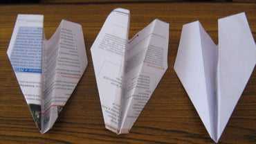 How Does the Design of a Paper Airplane Affect Its Flight?