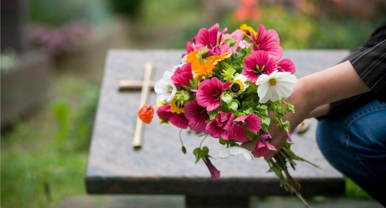 people-put-flowers-graves