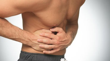What Does a Sharp Pain Under Your Back Rib Cage Mean?