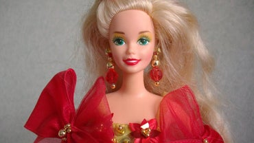 What Are the Values of Holiday Barbie Dolls?