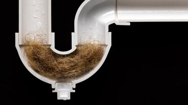 What Dissolves Hair in Drains?