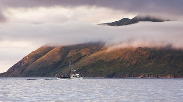 What Group of Small Islands Forms the Long Tail of Alaska?