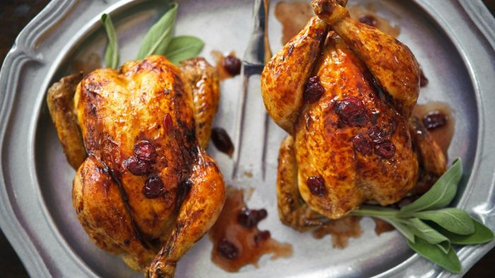 How do you prepare oven-roasted Cornish hens?