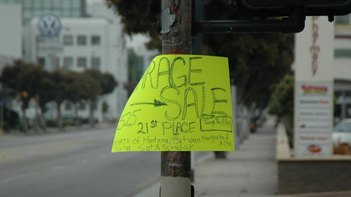 How can you find local garage sales in your community?