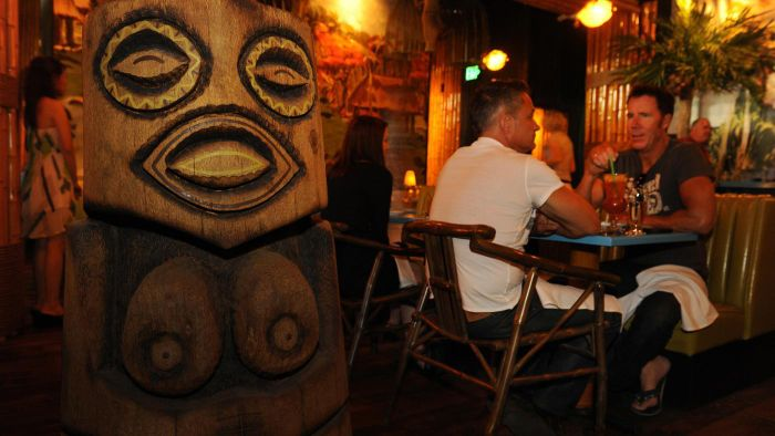 What are some fun designs for a backyard tiki bar?