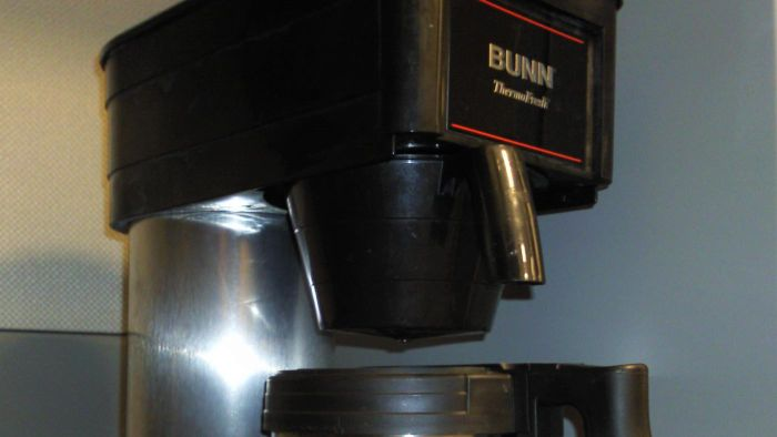 How do you repair a clogged coffee machine?