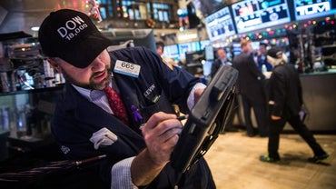Does the Dow Jones Stock Report Affect Interest Rates?