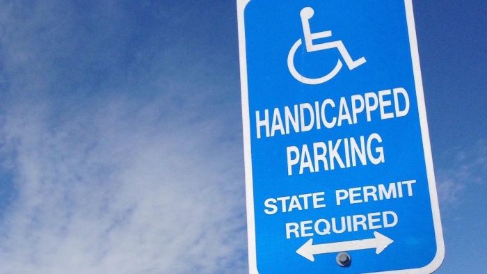 How do you obtain official wheelchair access signs?