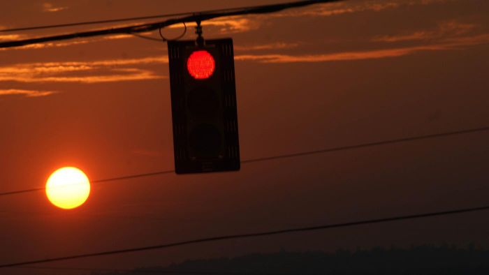 What Does a Red Blinking Traffic Light Indicate?