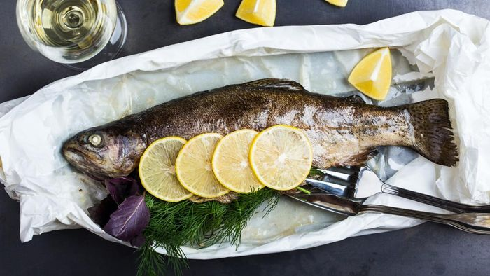 What Herbs Enhance the Flavor of Baked Rainbow Trout?