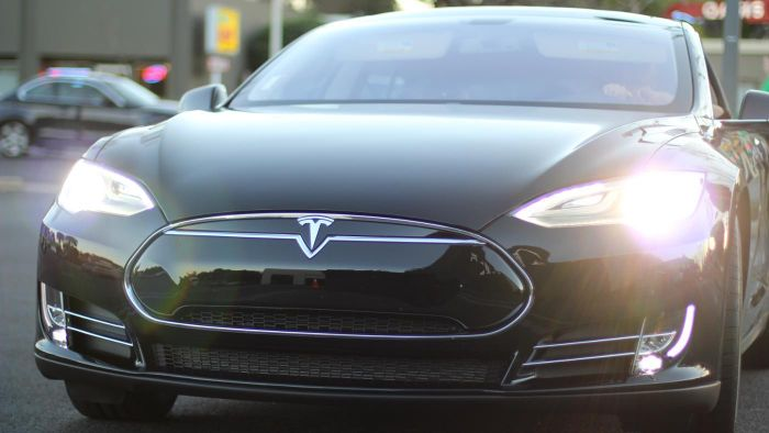 How does the price of Tesla cars compare to those of the rest of the auto industry?