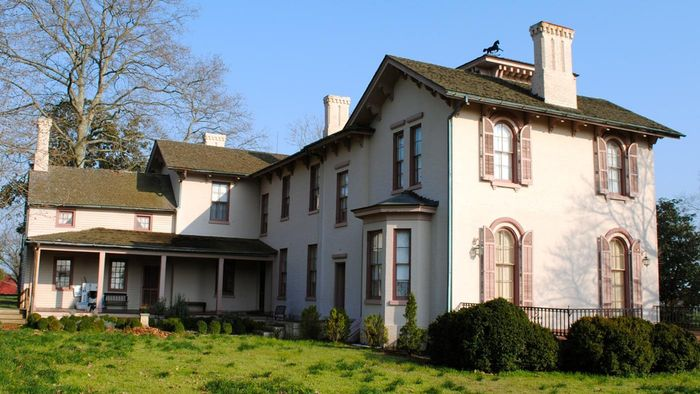 What publications list old mansions for sale?
