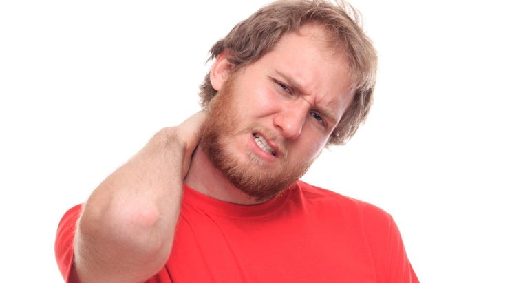 what are the main symptoms of a bulging disc in the neck