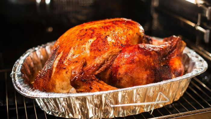 How do you cook a turkey in a roaster oven?