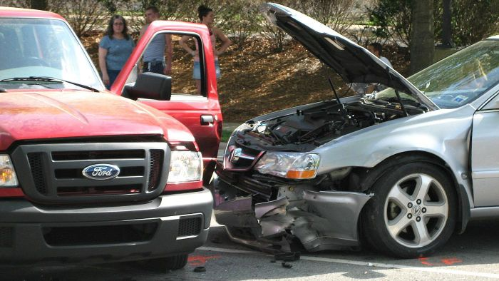 How Do Auto Insurance Companies Determine Payouts to Policyholders Involved in an Accident?