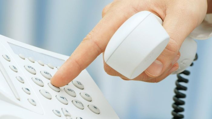 How Do You Dial a Phone Number Using a Country Code?