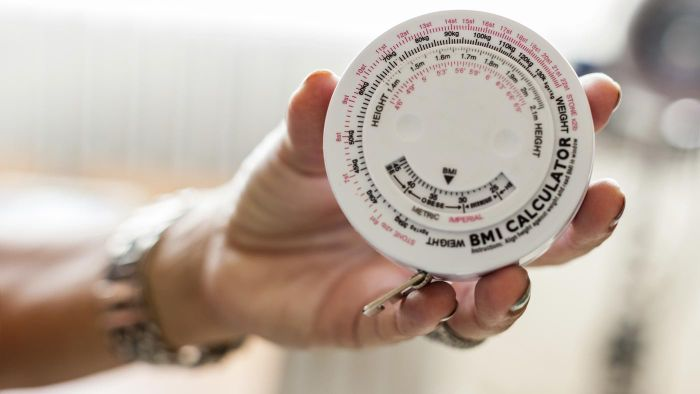 What BMI level is considered obese for women over 50?