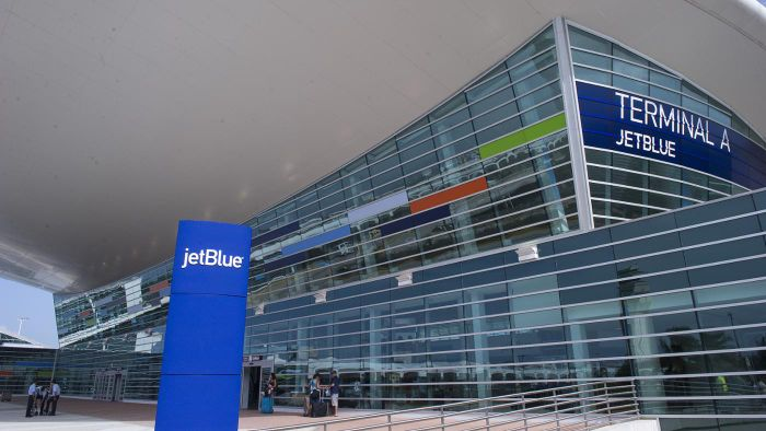 What are some of the transportation options available to and from San Juan Airport?