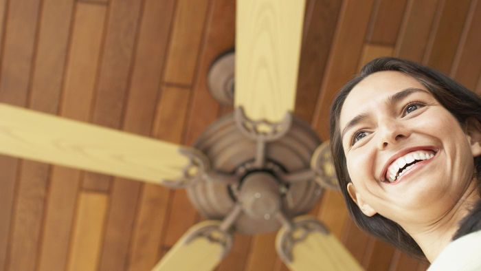 Are fans or air conditioners better for a two-story home?
