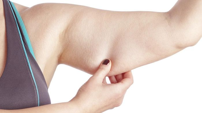 What are some surgical options for arm fat removal?