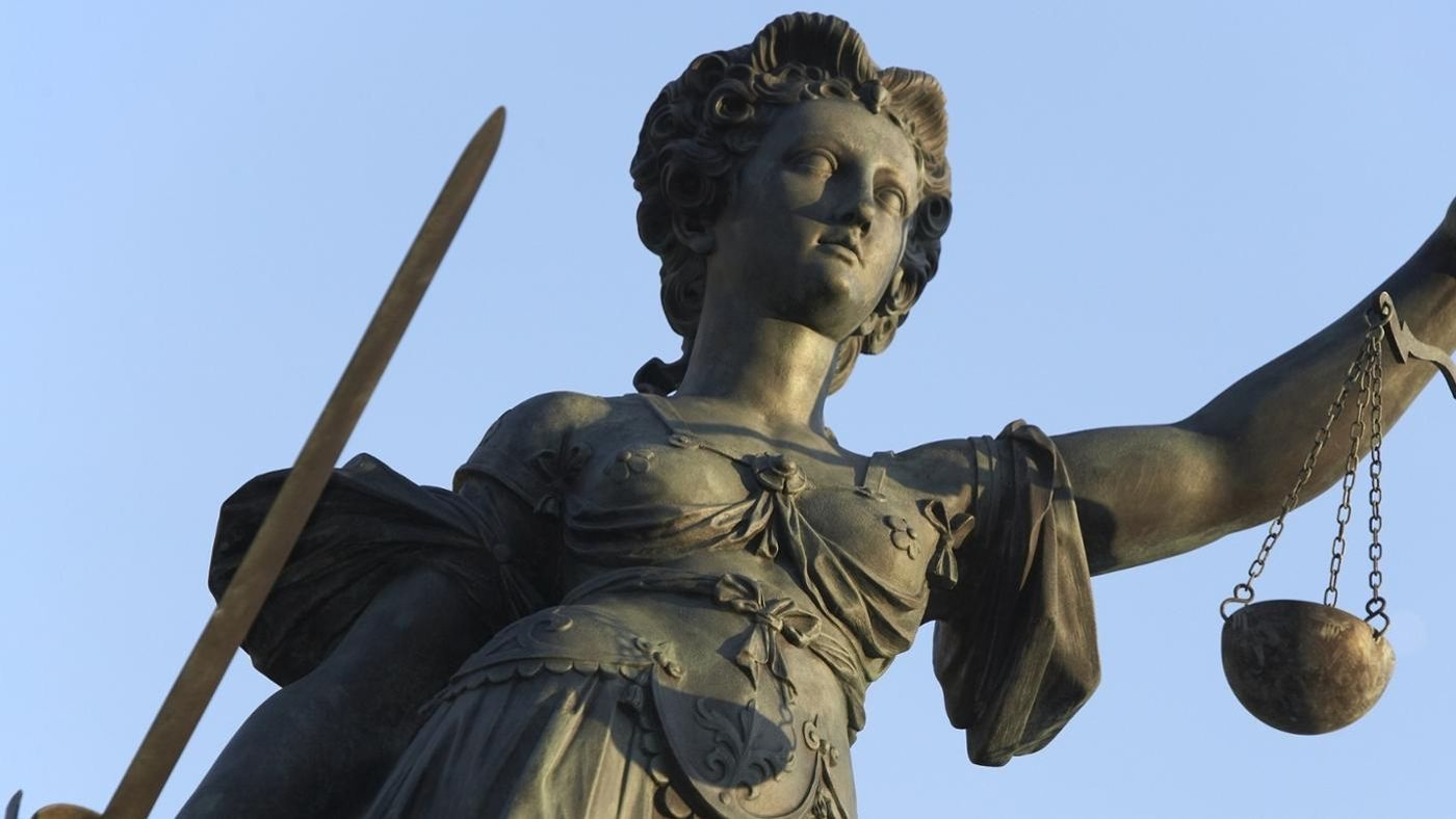 Why is lady justice holding a sword reference buycottarizona