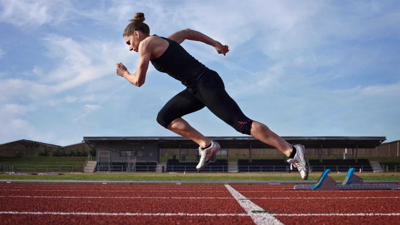 how many times around a standard running track is a mile