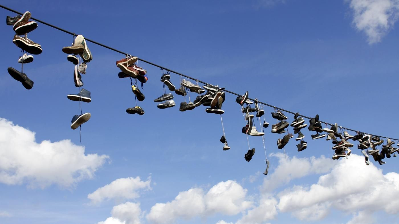 What Do Shoes Hanging On Power Lines Mean Reference Com