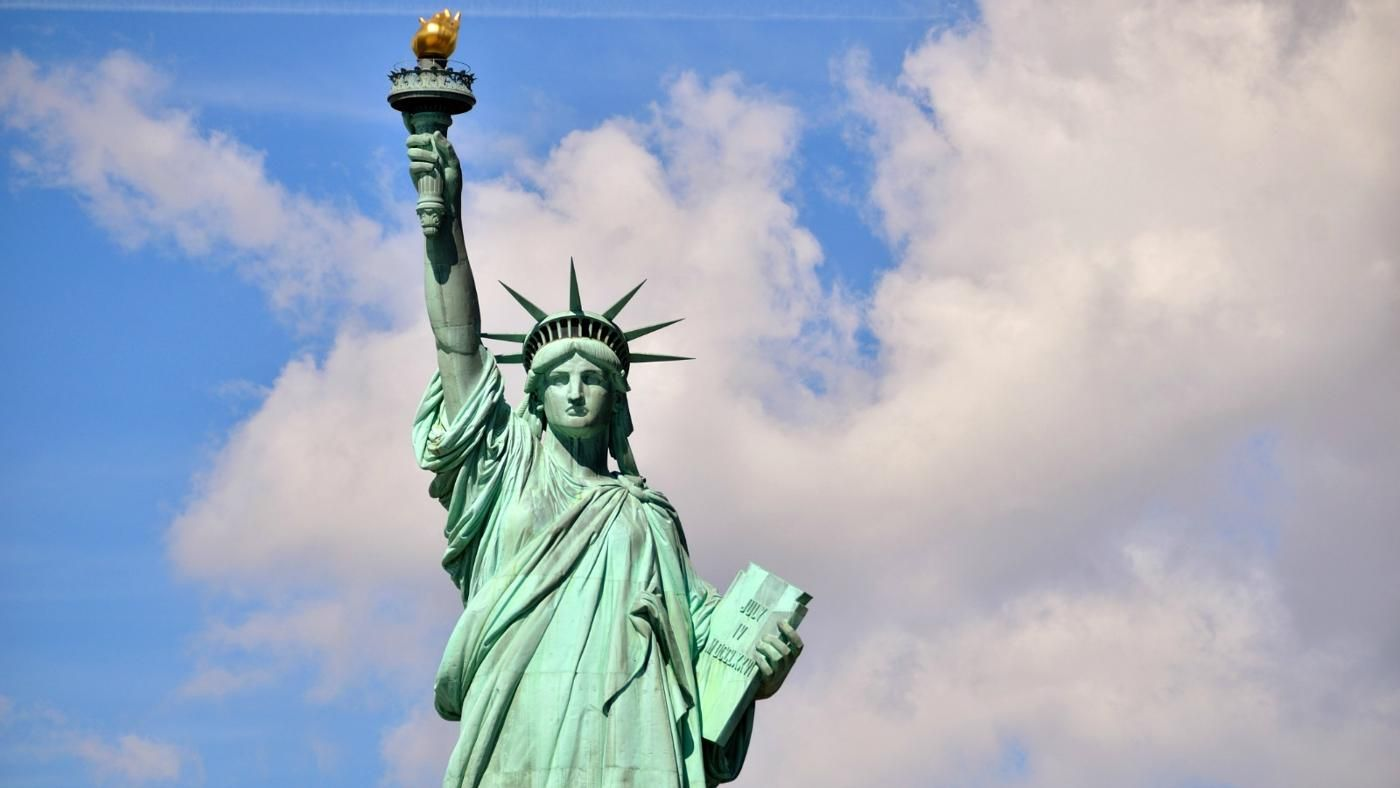 What does the tablet say on the statue of liberty reference biocorpaavc