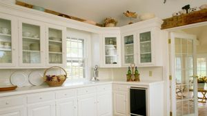 What can you use to decorate above the kitchen cabinets?