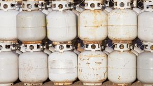 How do you check the level of a propane tank?