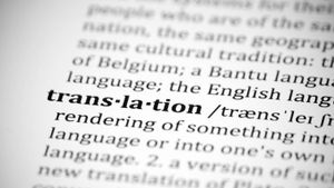 What is a computer language translator?