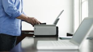 How do I connect a Wi-Fi printer to my laptop?