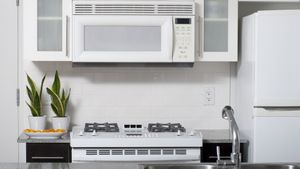 How Far Does an Over-Range Microwave Need to Be From the Top of the Range?