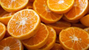 What does the fruit orange symbolize?