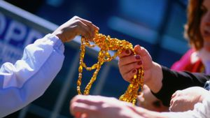 Why do people throw beads during Mardi Gras parades?