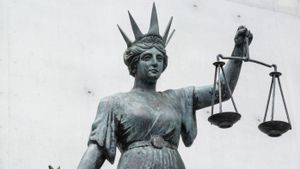 What do the scales of justice represent?